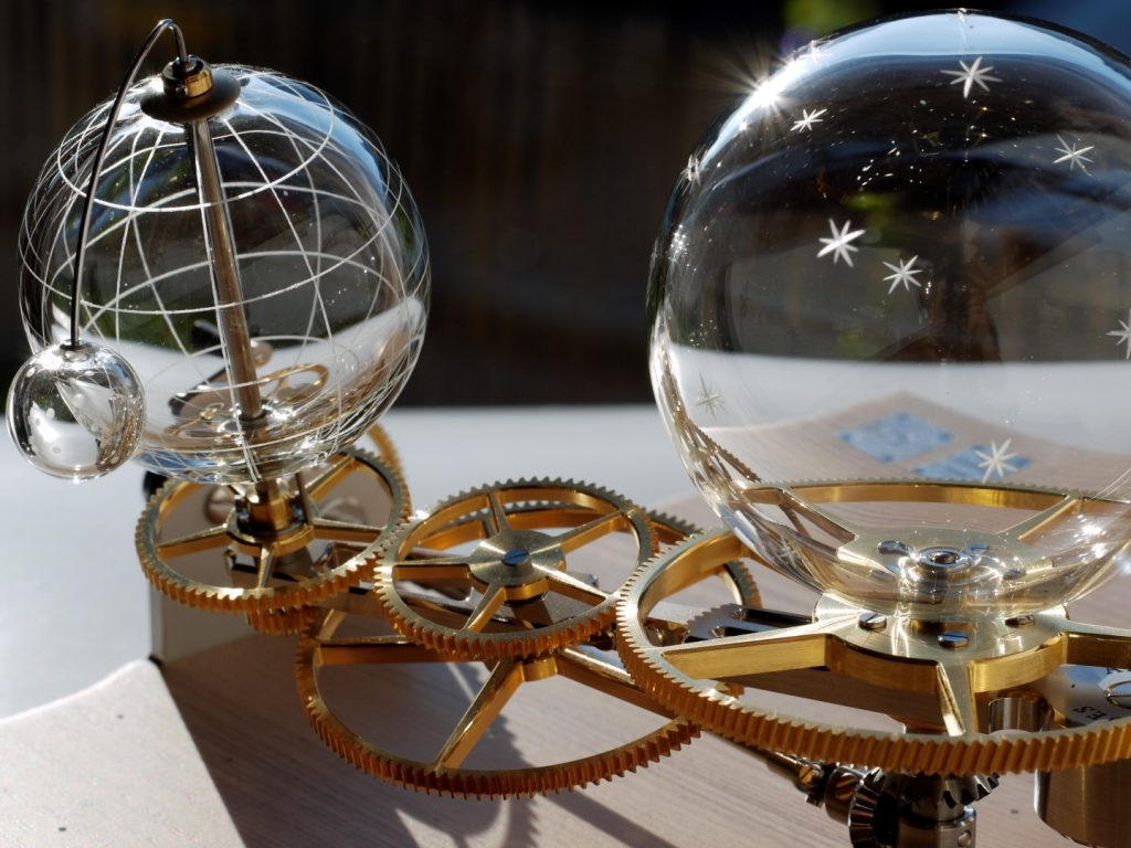 hand-blown glass orrery. mechanical glass mecanism. arts mecaniques. clock glass mecanism